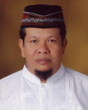 Drs. Parluhutan Siregar
